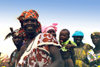 Djenn�, Mopti Region, Mali: women returning to the village after a day at the market - photo by N.Cabana