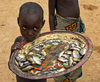 Djenn� cercle, Mopti Region, Mali: boy selling river fish in village near Djenne - photo by J.Pemberton