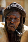 Djenn�, Mopti Region, Mali: portrait of a medicine man smoking a pipe at monday market - photo by J.Pemberton