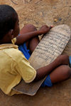 Djenné, Mopti Region, Mali: boy studying Quranic verses on a wooden tablet at the Madrassa - photo by J.Pemberton