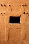 Bandiagara Escarpment, Dogon country, Mopti region, Mali: window decoration on a Dogon mud brick house - photo by J.Pemberton
