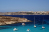 Malta - Comino: blue lagoon and Mgarr in the background (photo by A.Ferrari)