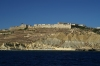 Gozo / Ghawdex: Mgarr - Fort Chambray - from the sea (photo by  A.Ferrari )