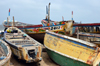 Nouakchott, Mauritania: traditional wooden fishing boats, locally built and painted - fishing harbor, the Port de Pêche - photo by M.Torres