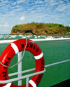 Mamoudzou, Grande-Terre / Mahore, Mayotte: Pointe Mahabou seen from the ferry - life preserver on ship railing - lifebuoy of Salama Djema II - photo by M.Torres
