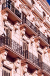 Spain - Melilla: pink fa�ade - balconies with console brackets - | fachada rosa - photo by M.Torres