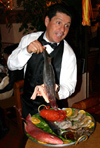 San Miguel de Allende (Guanajuato): waiter showing the fish -  El Campanario Restaurant (photo by R.Ziff)