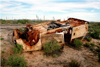 Mexico - Bahia De Los Angeles (Baja California): abandoned car rusting in the desert - rollover accident by G.Friedman