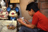 Guanajuato City: boy reading comics book - Buddha and Mickey Mouse - photo by Y.Baby