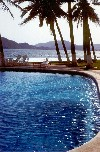 Mexico - Manzanillo / ZLO (Colima): pool, palms and bay (photo by Terry Prosser)