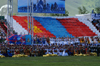 Ulan Bator / Ulaanbaatar, Mongolia: Naadam festival - giant flag and singers at the opening ceremony - photo by A.Ferrari