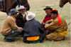 Ulan Bator / Ulaanbaatar, Mongolia: Naadam festival - men talking about the horse race - photo by A.Ferrari