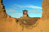 Gobi desert, southern Mongolia: tower - new buildings in the ruins of a monastery complex, Ongiin Khiid - photo by A.Ferrari