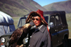 Mongolia - Altai - western Mongolia: Kazakh eagle hunter and Russian Jeep - photo by A.Summers