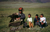 Mongolia - Altai: Kazak eagle hunter and family - photo by A.Summers