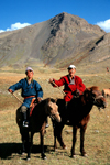 Mongolia - Uvs province: nomadic hearders posing posing with their horses - photo by A.Summers