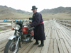 Mongolia - Arkhangai - Great White Lake / Terkhiin Tsagaan Nuur: man and motorbike - photo by P.Artus