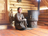 Mongolia - Arkhangai - Great White Lake / Terkhiin Tsagaan Nuur: woman at home by the stove - photo by P.Artus