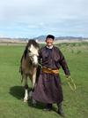 Mongolia - Burgun, Bayan-Ölgiy Aymag: horseman proud of his steed - Mongolian cowboy - photo by P.Artus