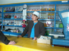 Mongolia - Burgun, Bayan-Ölgiy Aymag: shopkeeper - woman - photo by P.Artus