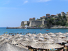 Montenegro - Crna Gora - Ulcinj / Dulcigno / Ulqin: fortress where Miguel de Cervantes was held hostage and beach umbrellas - photo by J.Kaman - photo by J.Kaman