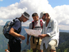 Montenegro - Crna Gora - Durmitor national park: hikers reading a map - orientation - photo by J.Kaman