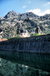 Montenegro - Kotor: walls, moat, churches and castle - photo by D.Forman