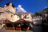 Montenegro - Kotor: clock tower, café and castle - photo by D.Forman