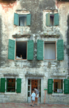 Montenegro - Crna Gora - Kotor: façade - residential building - green shutters - photo by J.Banks