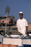 Morocco / Maroc - Marrakesh: Arab man selling snails as a snack - food stall at Place Djemaa el Fna - photo by F.Rigaud