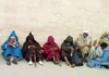 Morocco / Maroc - Fez: colours - men in jallabas against a wall - photo by J.Kaman