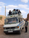 Morocco / Maroc - Dades gorge: grand taxi / shared taxi - all aboard? - Marcedes van - photo by J.Kaman