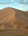Morocco / Maroc - Erg Chebbi: scale - dune and man - desert - photo by J.Banks
