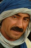 Morocco / Maroc - Man drafting a smile - photo by J.Banks