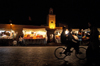 Morocco - Marrakech: Place Djemaa el Fna - night - minaret and bike - photo by M.Ricci
