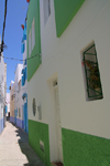 Asilah / Arzila, Morocco - blue and green houses - photo by Sandia
