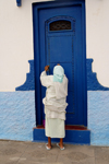 Asilah / Arzila, Morocco - woman and blue door - Medina - photo by Sandia