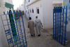 Asilah / Arzila, Morocco - men walking streets of Medina - photo by Sandia