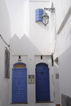 Asilah / Arzila, Morocco - blue doors on whitewashed houses - photo by Sandia