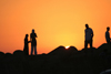 Asilah / Arzila, Morocco - popular place for sunset stroll - people silhouettes - photo by Sandia