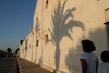 Asilah / Arzila, Morocco - palm tree shadow - waterfront street - photo by Sandia