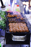 Agadir, Morocco: market - selling BBQ meat - kebabs - photo by Sandia