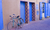 Tiznit - Morocco: bike and blue doors - photo by Sandia