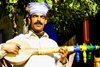 Morocco: Berber singer on the road - photo by Sandia