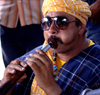 Marrakesh - Morocco: Djema El Fnaa - musician - photo by Sandia
