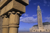 Casablanca, Morocco: detail of pillars and Hassan II mosque in the background- photo by S.Dona'