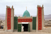 Morocco / Maroc - Imilchil: mosque covered in Moroccan flags - photo by F.Rigaud