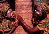 Mozambique / Moçambique - Pemba: two maconde women with musiro masks around a tree / mulheres com mascaras de beleza musiro - ximbuti - photo by F.Rigaud