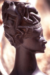 Pemba / Porto Amélia, Cabo Delgado, Mozambique / Moçambique: wooden bust - woman with men on her head - Makonde art / escultura Maconde - busto - photo by F.Rigaud