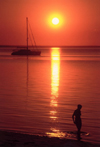 Mozambique / Mo�ambique - Benguerra island / ilha, Vilanculos District, Inhambane province: sunset on the beach - yacht and woman silhouette / p�r do sol na praia - photo by F.Rigaud